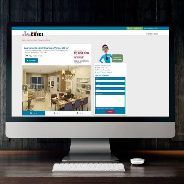Computador com site Portal Imobiliário CRECI SP na tela de detalhamento de apartamento formuário